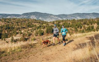 Couple Running on Wilden trails with dog image