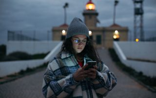 young woman look at smartphone in dusk light image